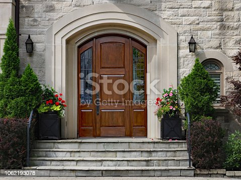 elegant front door of stone house with flagstone steps