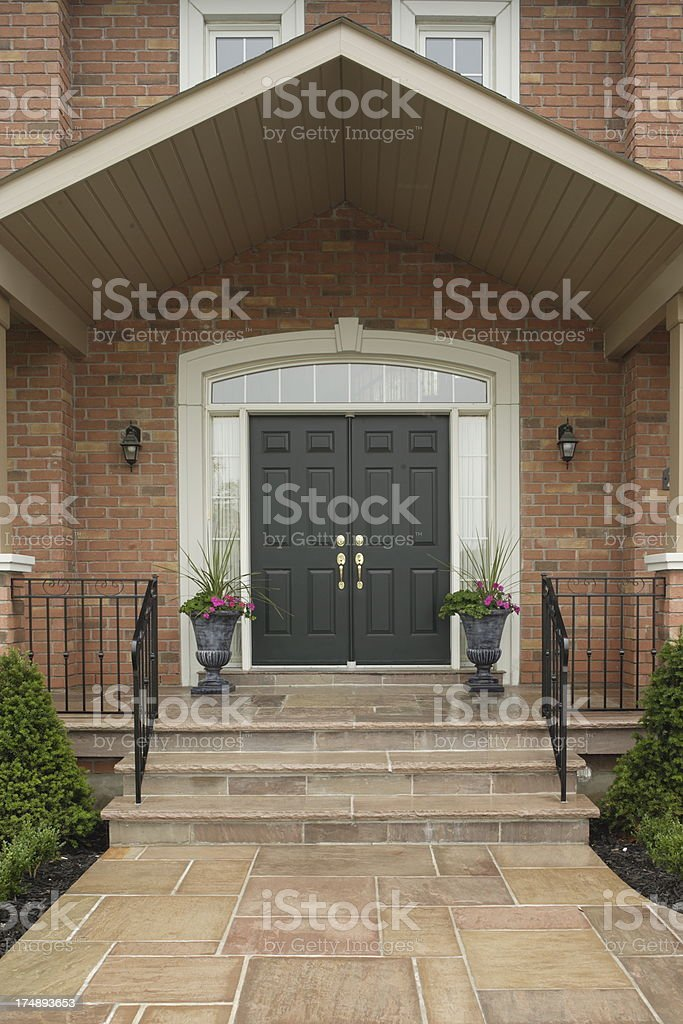Front Entrance of the Private residence feturing elegant landscaping