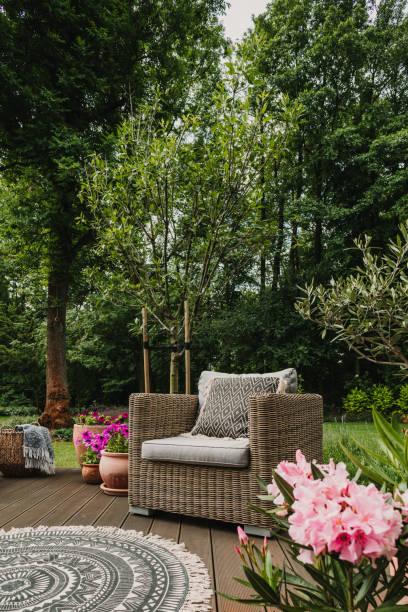 Elegant garden furniture on terrace of suburban home stock photo