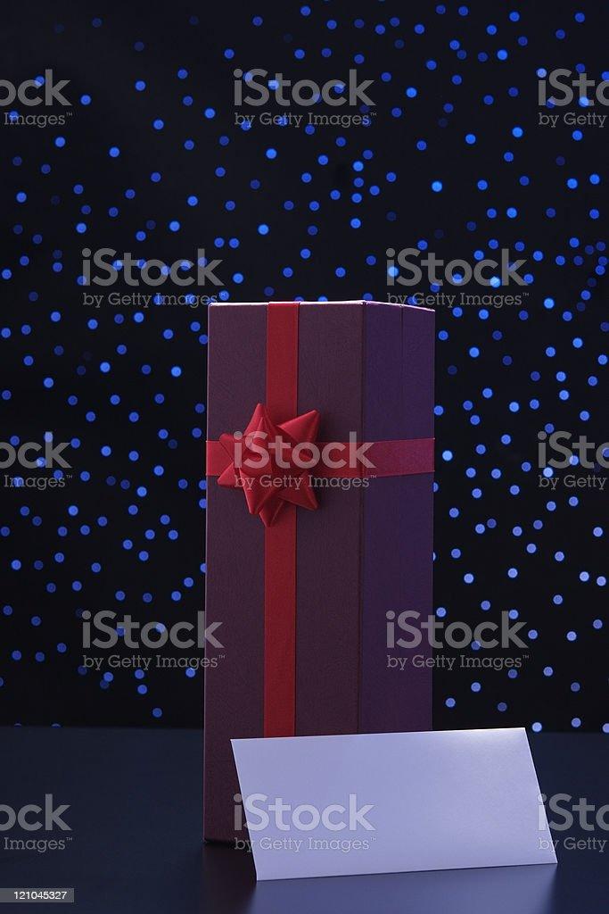 Elegant gift box and blank envelope against blue illumination background royalty-free stock photo