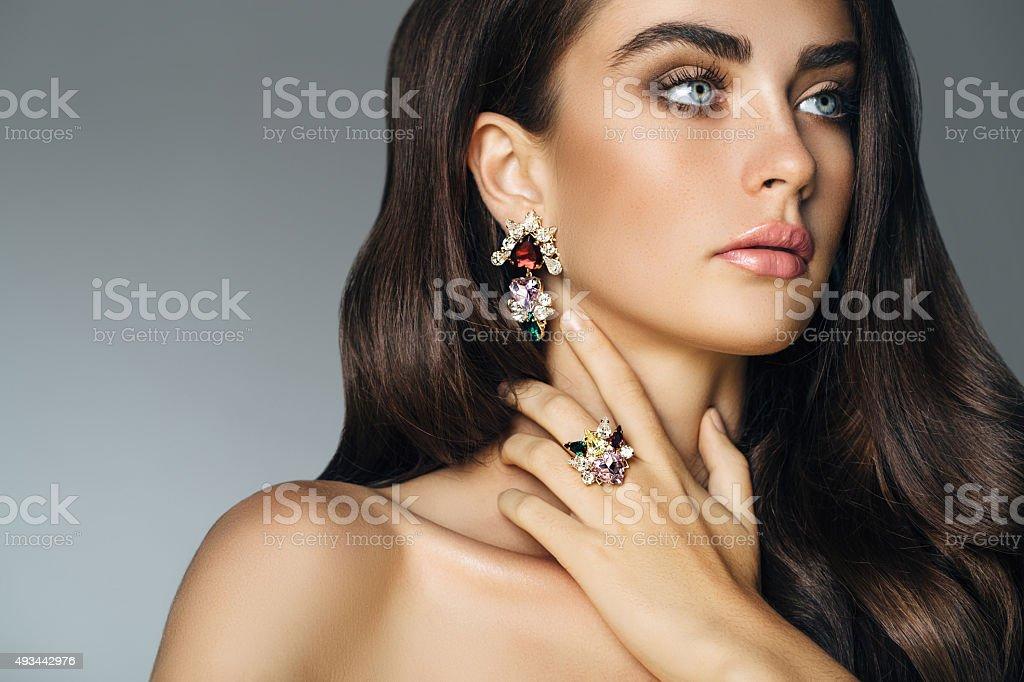 Elegant girl advertising jewelry stock photo