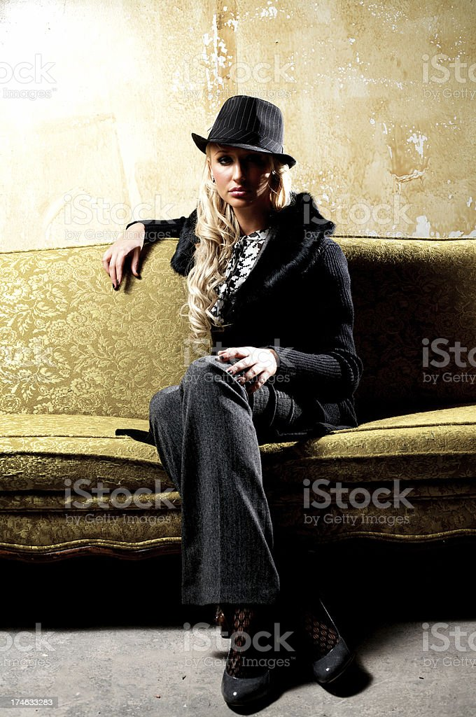 elegant girl sitting on a couch royalty-free stock photo