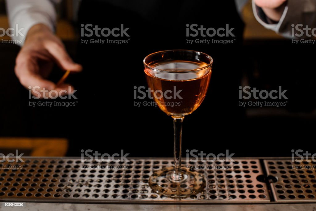Elegant glass filled with light alcoholic drink stock photo