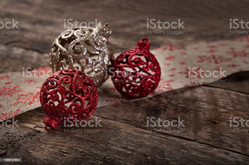 Elegant Glittering Christmas Ornaments Sitting On Table With Jute