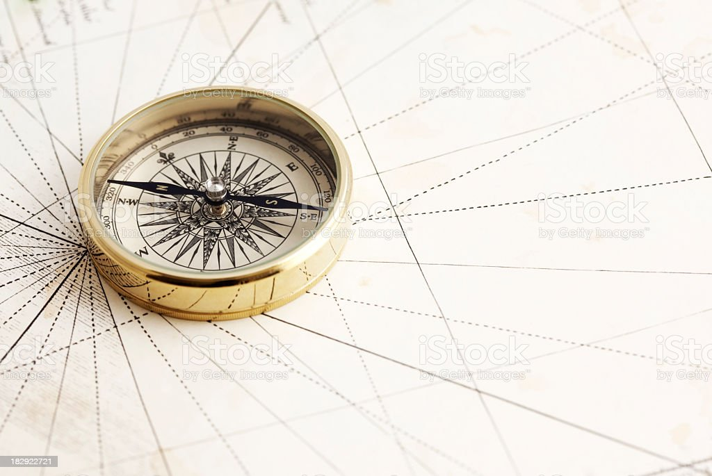 Elegant gold compass stock photo