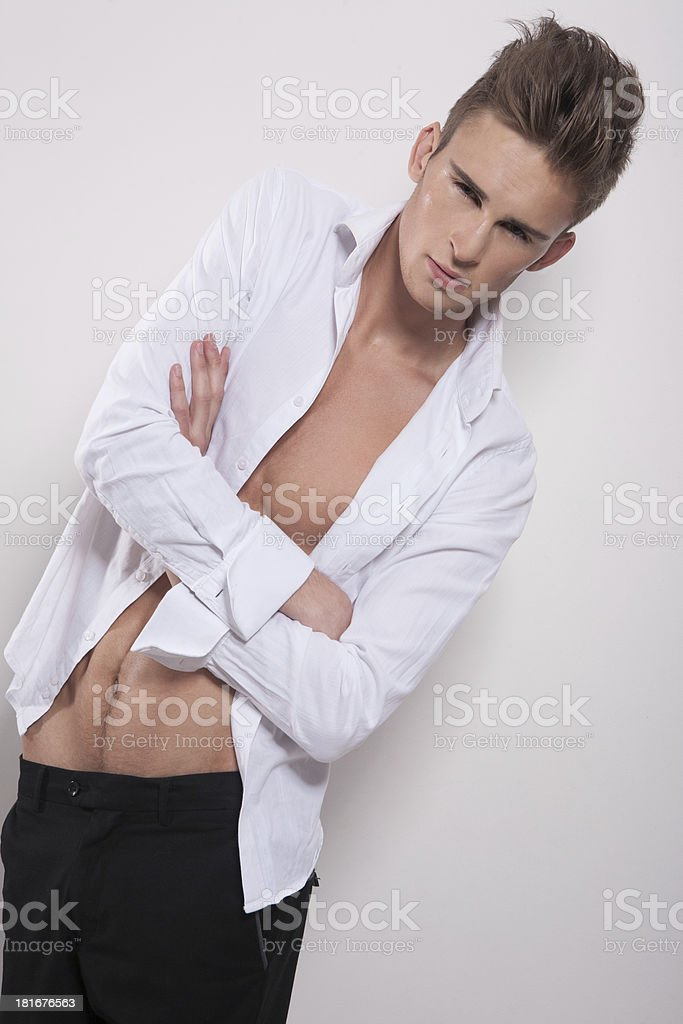 Elegant guy with crossed hands looking at camera royalty-free stock photo