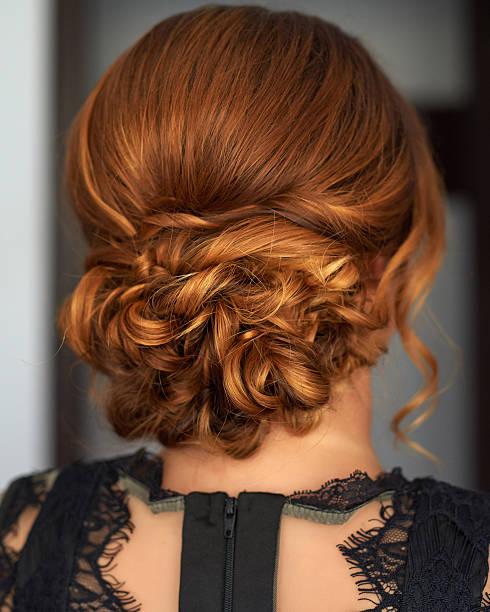 elegant hair bun - kabarık saç stok fotoğraflar ve resimler