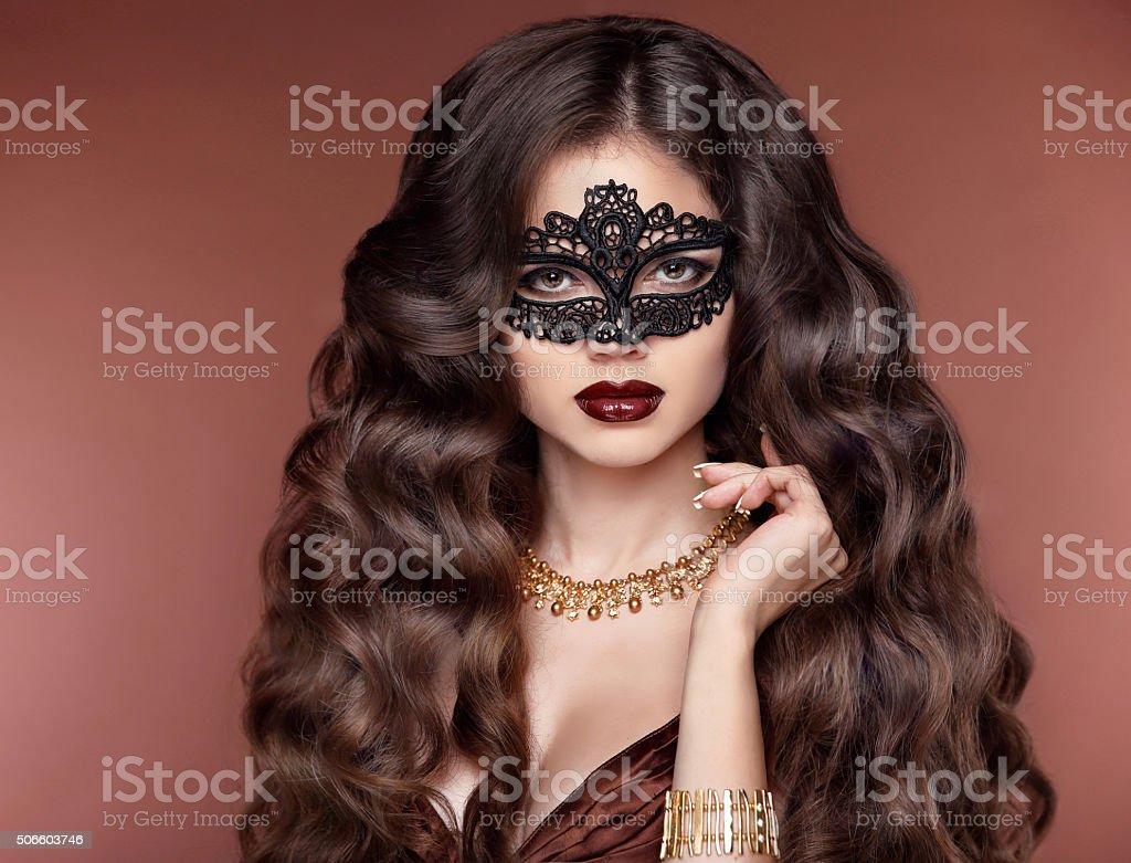 elegant hairstyle. Beautiful brunette girl model. Fashion golden stock photo