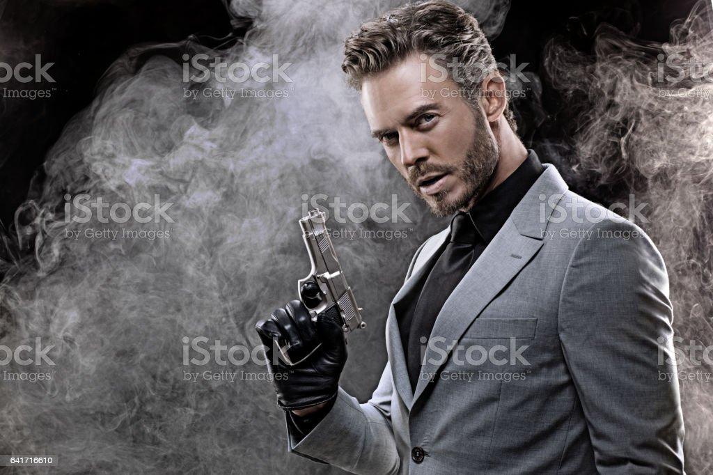 Elegant handsome gangster man in studio shot stock photo