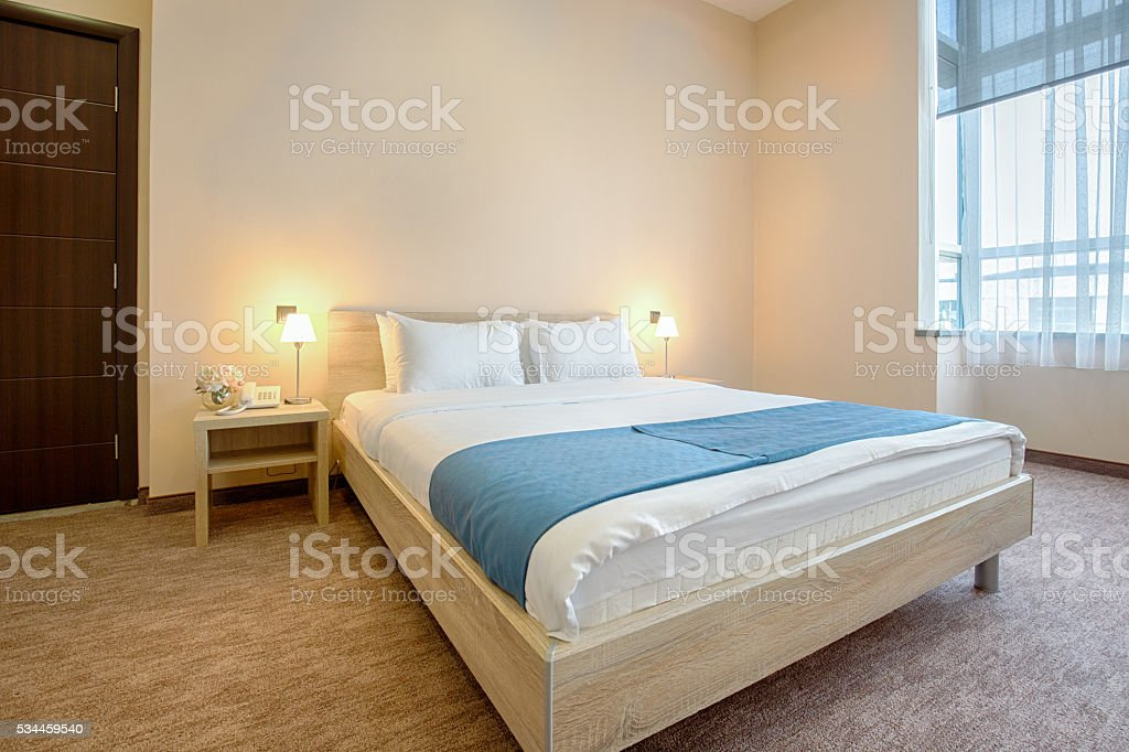 Elegant hotel bedroom interior stock photo