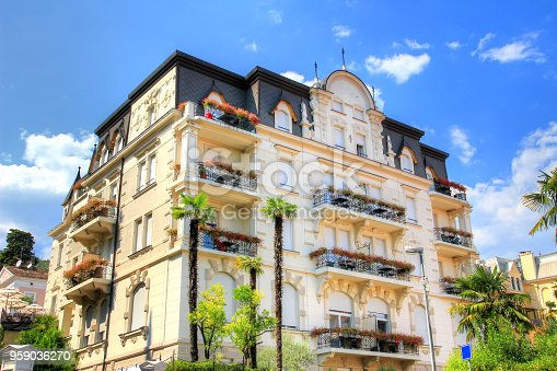 Elegant house with balconies in summer sunshine from streets of seaside resort town Abbazia in former Austrian Riviera from Austro-Hungarian Empire era, today city of Opatija Croatia Istrian peninsula Europe
