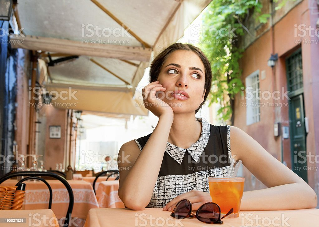 Elegant Italian girl drinking aperitif royalty-free stock photo