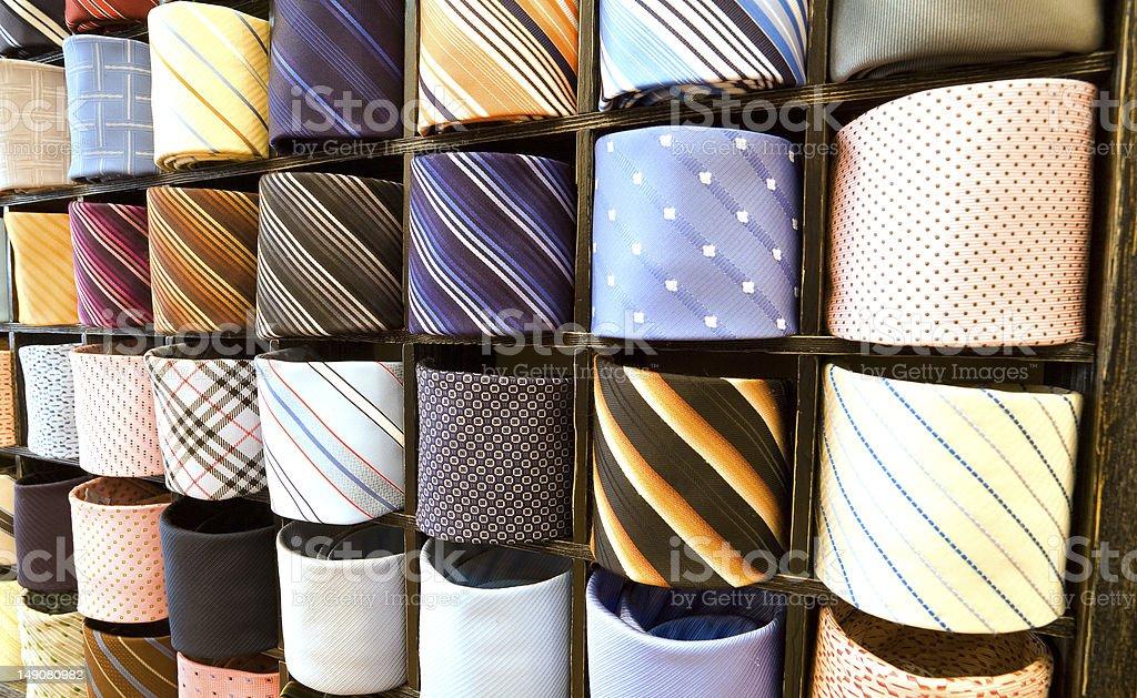 Elegant italian neckties in a tie rack royalty-free stock photo