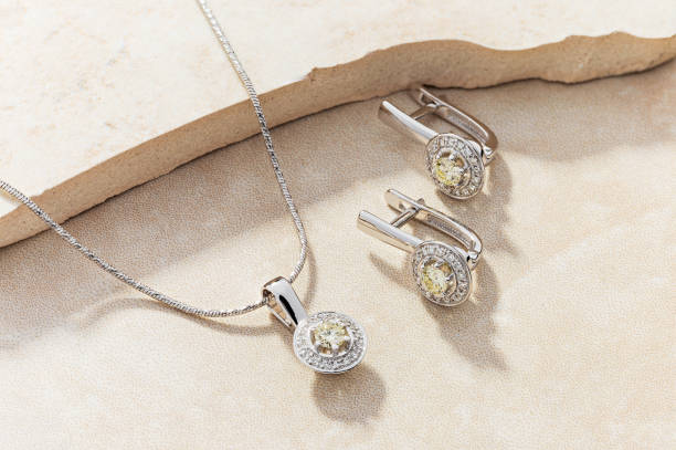 Elegant jewelry set of white gold necklace and earrings with diamonds stock photo