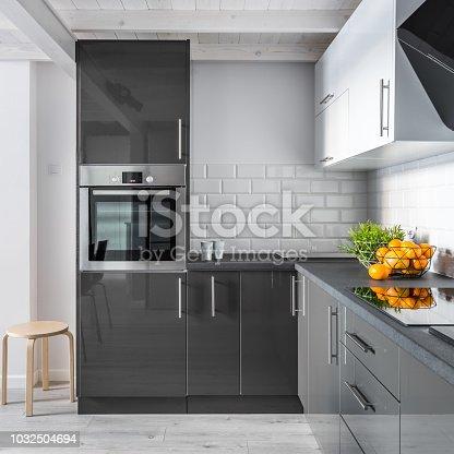 Elegant kitchen interior with brick tiles and modern cupboards