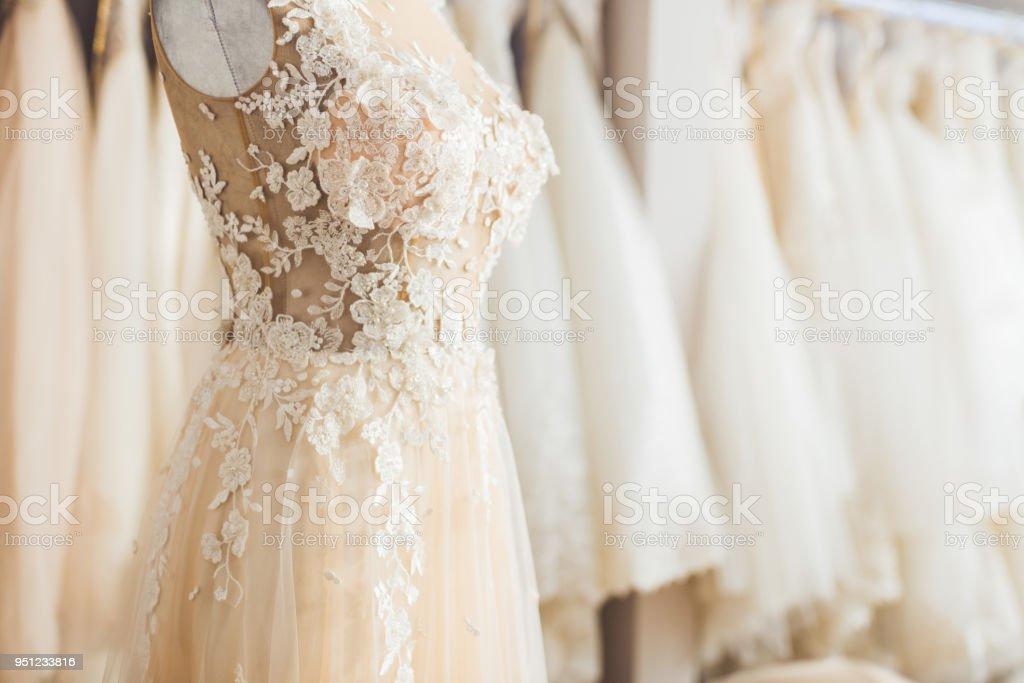 Elegant lace dress on dummy in wedding fashion shop stock photo