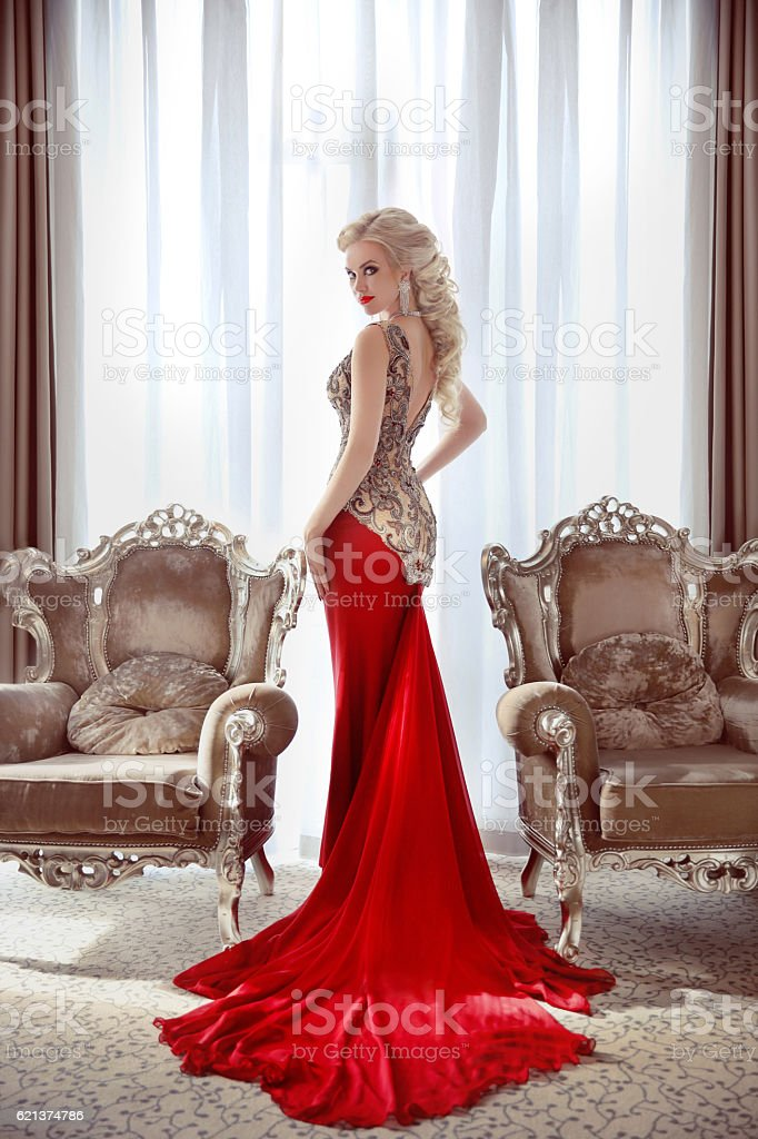 Elegant lady. Beautiful blond woman model in fashion dress stock photo