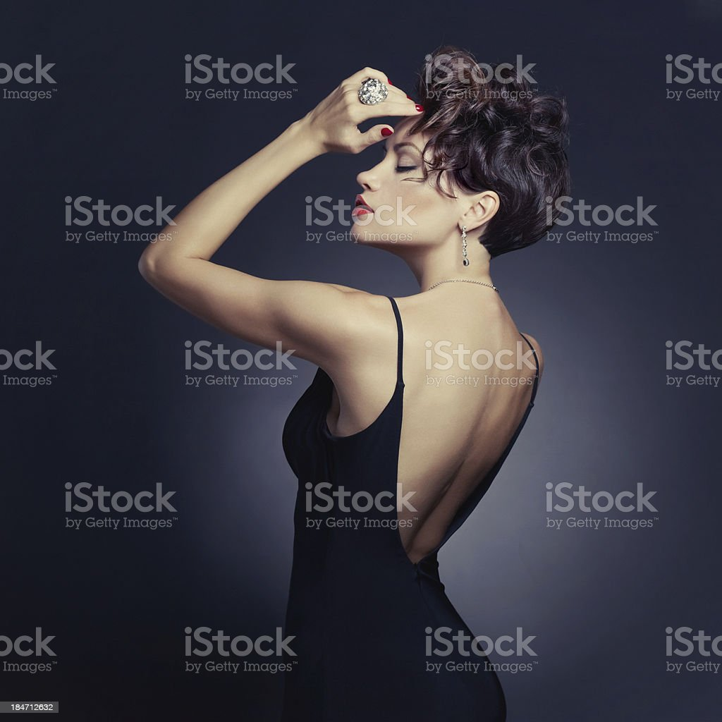 Elegant lady in evening dress stock photo