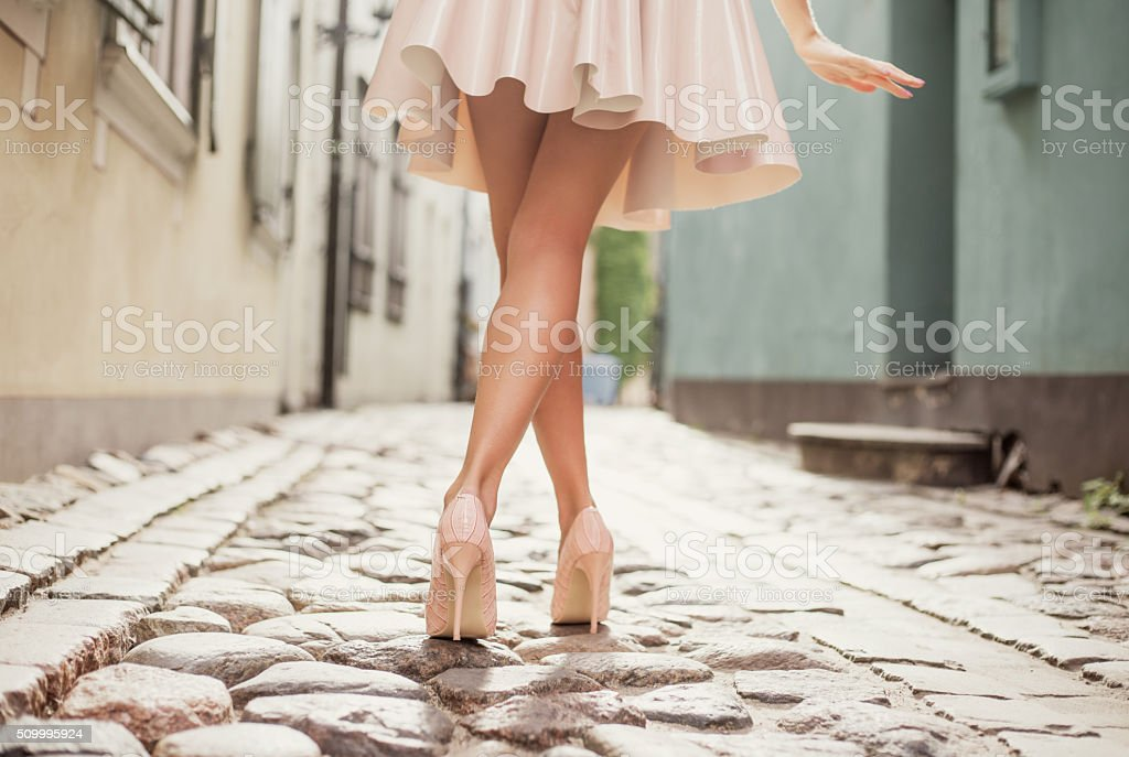 Elegant lady walking alone in the street stock photo