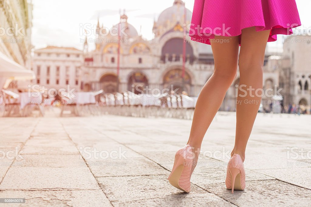 Elegant lady with beautiful legs in high heel shoes Elegant lady with beautiful legs in high heel shoes in Venice Adult Stock Photo