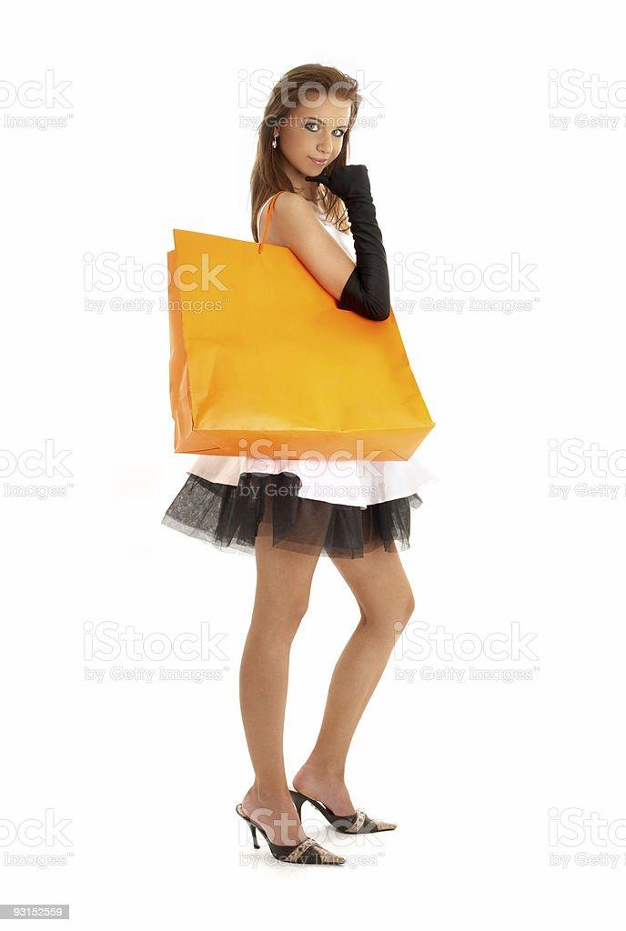 elegant lady with orange shopping bag #2 royalty-free stock photo