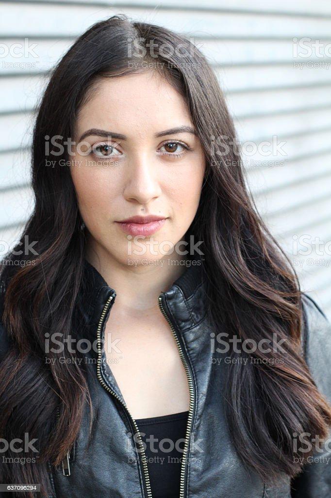 Elegant Latina model with long dark hair stock photo