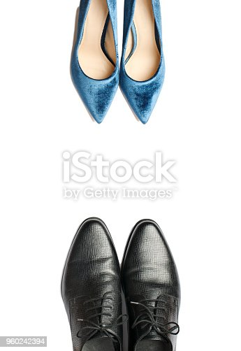 Elegant leather men's shoes and velvet blue women's high heel shoes. Top view, copy space