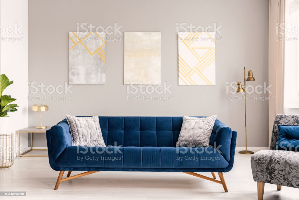 Picture of: Elegant Living Room Interior With A Comfortable Big Blue Velvet Sofa And Gold Decorations Real Photo Stock Photo Download Image Now Istock