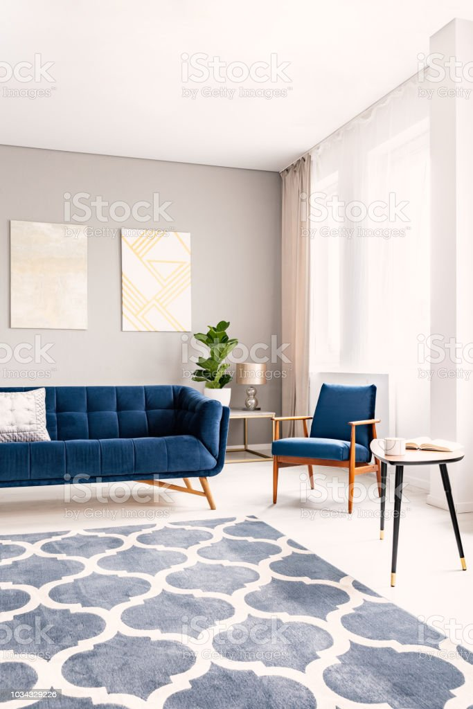 Elegant Living Room Interior With A Dark Blue Couch And A Matching Armchair Large Windows With Drapes And A Decorative Rug Real Photo Stock Photo Download Image Now Istock
