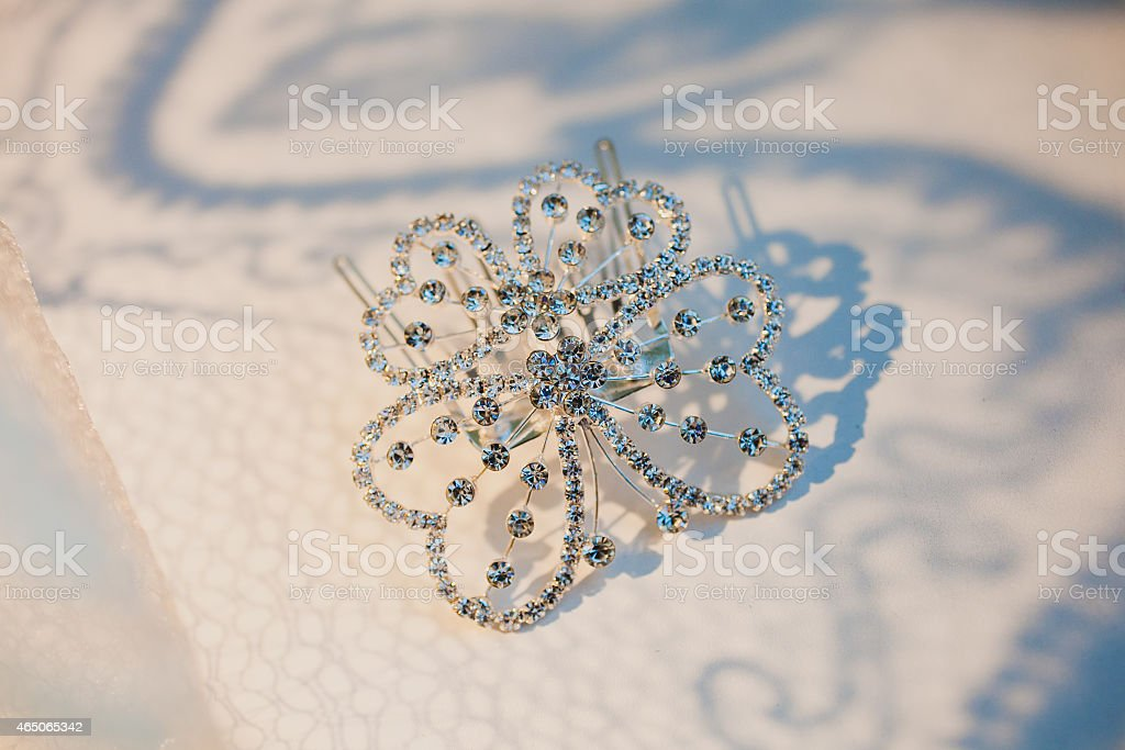 Elegant luxury bridal hair-pin on the white, styled with stock photo