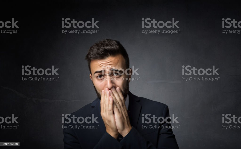 elegant man desperation face stock photo