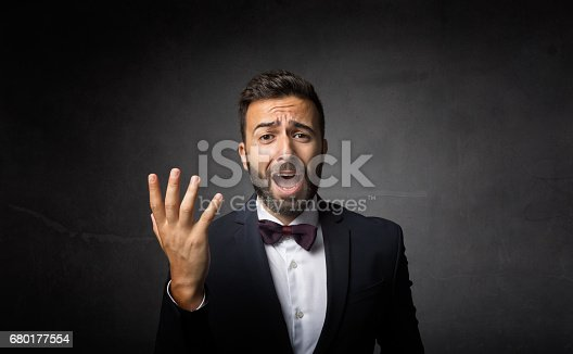 elegant man dramatic singing, dark background