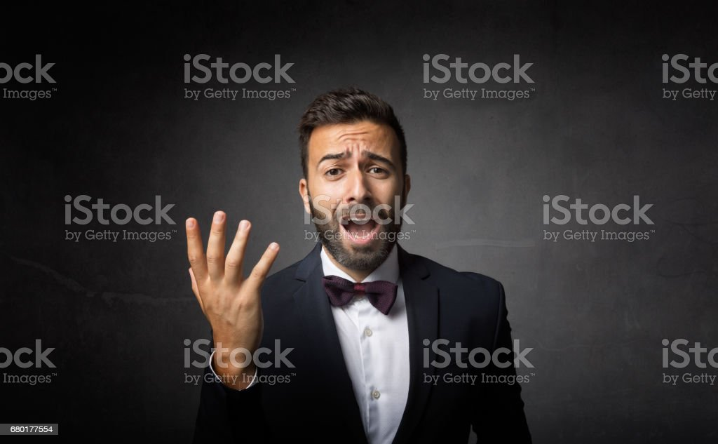 elegant man dramatic singing stock photo