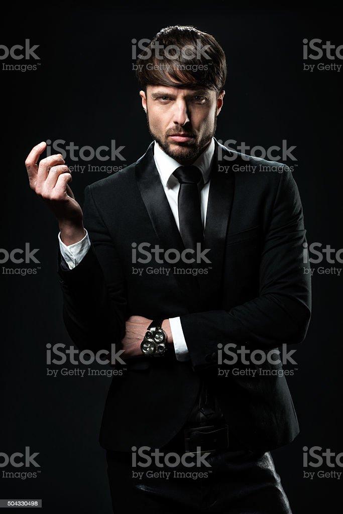 Elegant man dressed in black stock photo