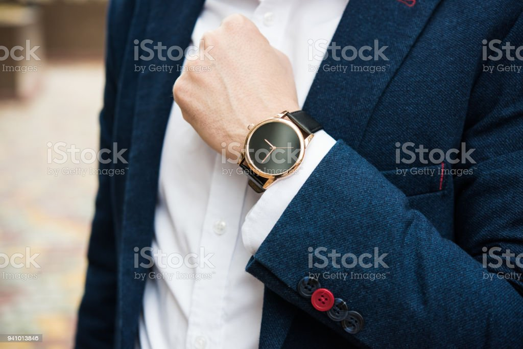 Elegant man in blue suit, business man's hand with fashion no br stock photo