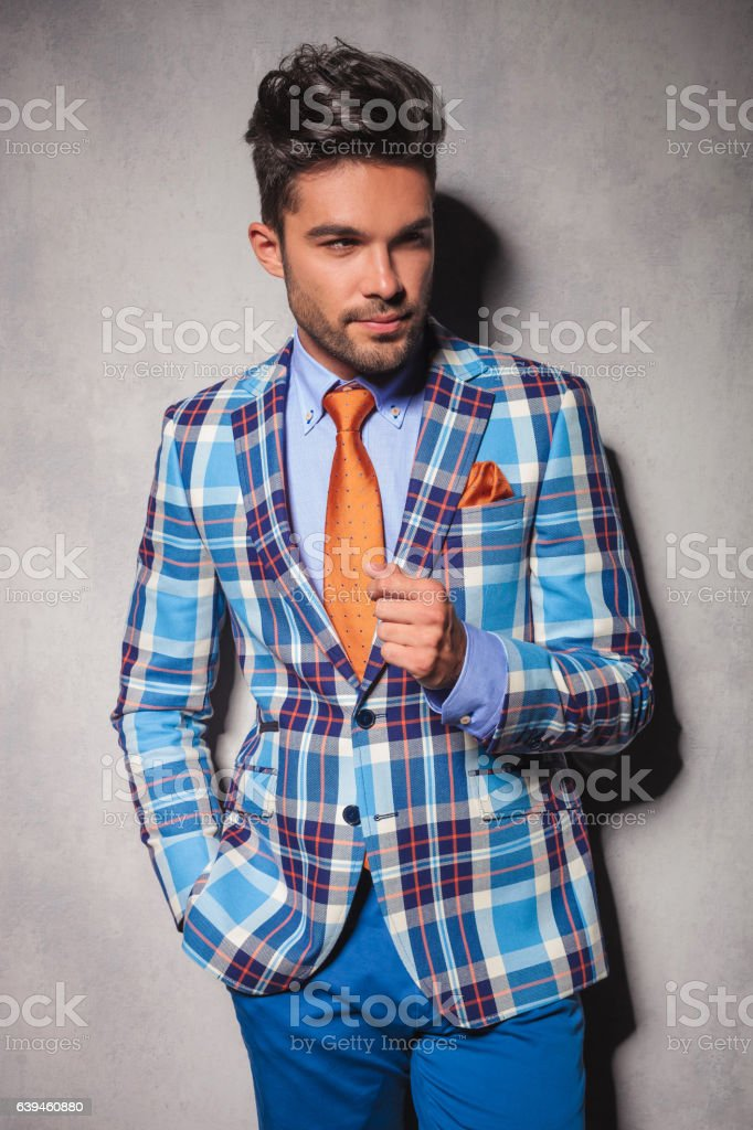 elegant man in checkered suit with hand in pocket stock photo