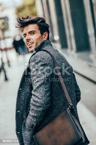istock Elegant man in the city 903932124