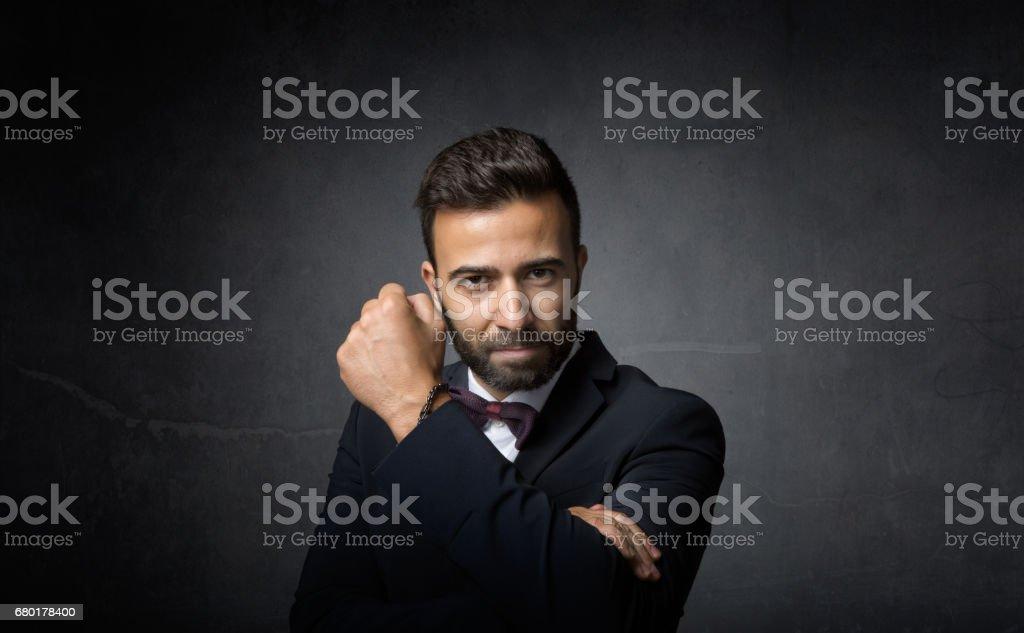 elegant man made rude umbrella gesture stock photo