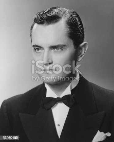 istock Elegant man posing in studio, (B&W), close-up, portrait 57260495