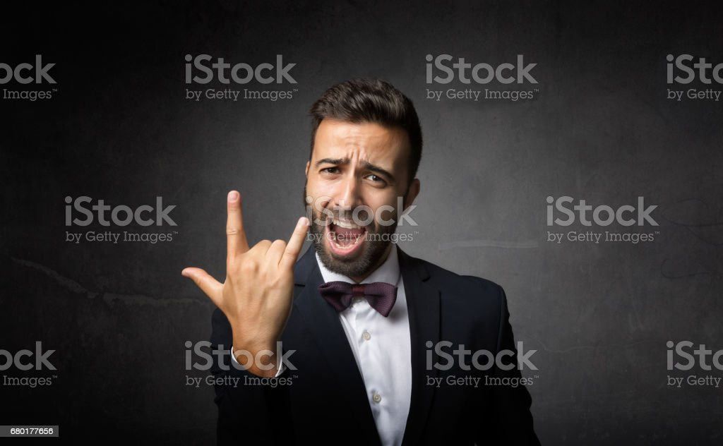elegant man rock gesture stock photo