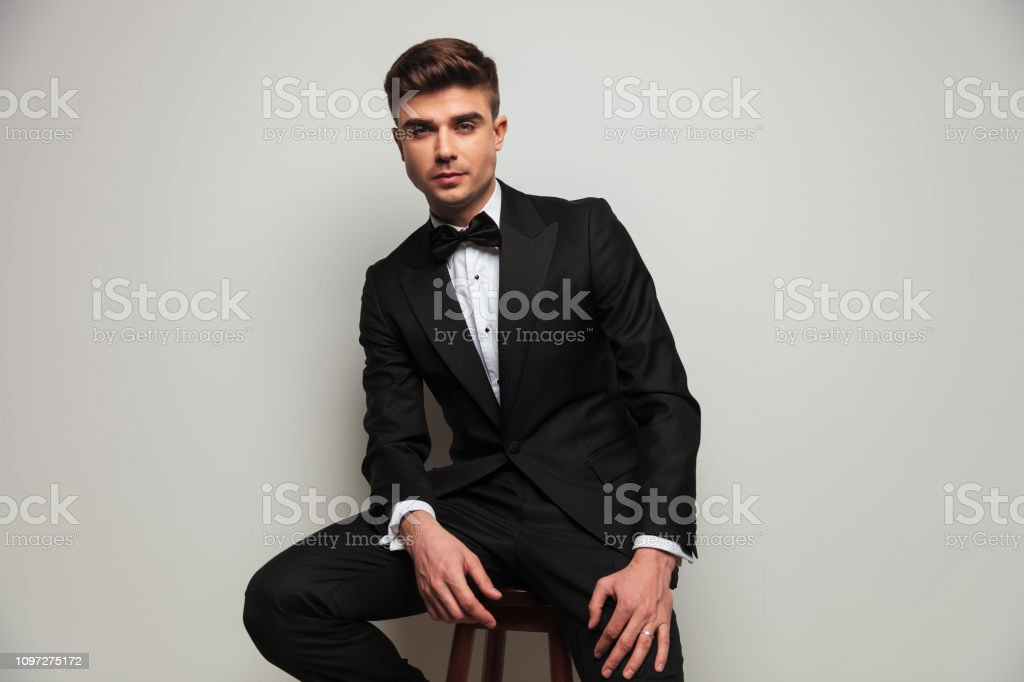 Cool Elegant Man Wearing Black Tuxedo Sits On Wooden Stool Stock Ocoug Best Dining Table And Chair Ideas Images Ocougorg