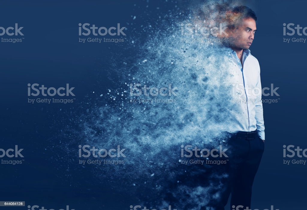 elegant man with a pixel dispersion effect over a gray background