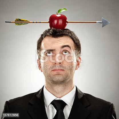 istock Elegant man with an apple on his head hit by an arrow 157612656
