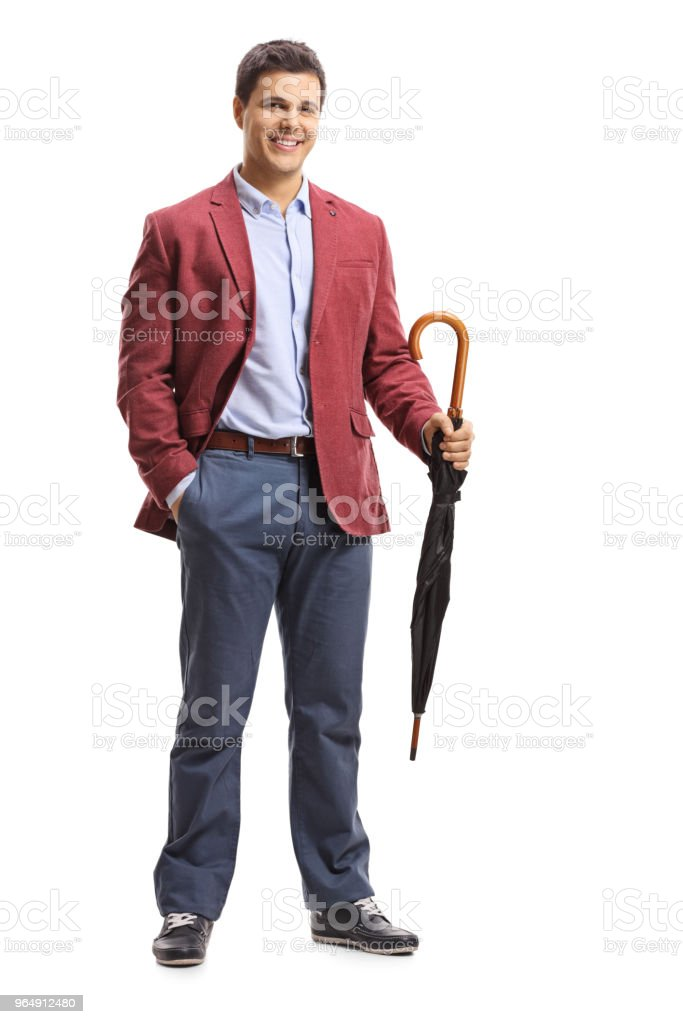 Elegant man with an umbrella royalty-free stock photo