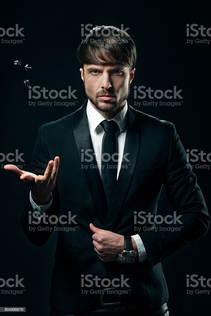 Elegant man with dices stock photo