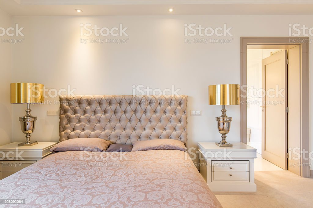 Elegant master bedroom with bed stock photo
