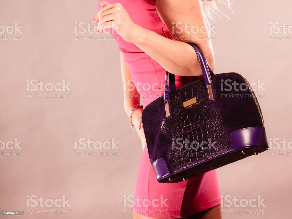 Elegant mid aged woman in dress with bag. stock photo