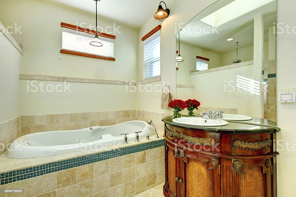 Picture of: Elegant Modern Bathroom With An Antique Wooden Storage Cabinet Stock Photo Download Image Now Istock