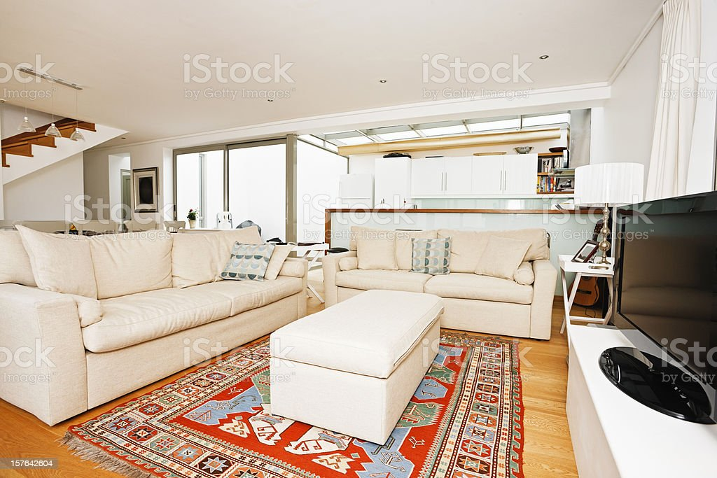 Elegant modern living room in upmarket duplex development stock photo