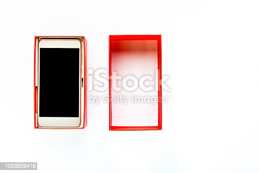 1161116588istockphoto Elegant modern smartphone, box with smart phone with black screen, wireless technology concept 1053839416